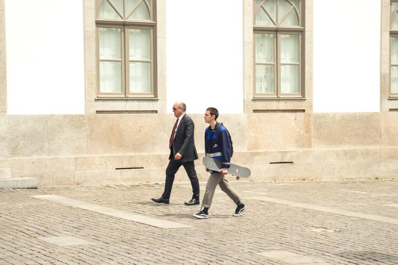 older man and younger man walking together
