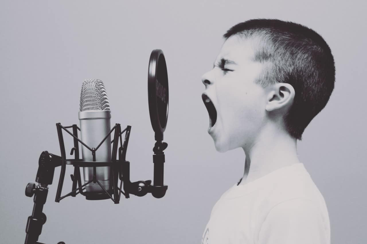 boy yelling into microphone